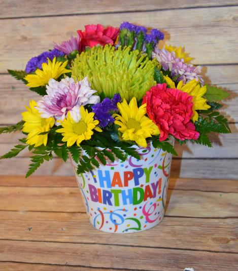 fresh cut flowers in a happy birthday confetti pot with bright assorted flowers