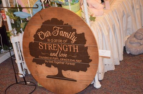Our family is a circle of love and strength round wood sign, Leonard Muller Funeral Home Manchester Iowa